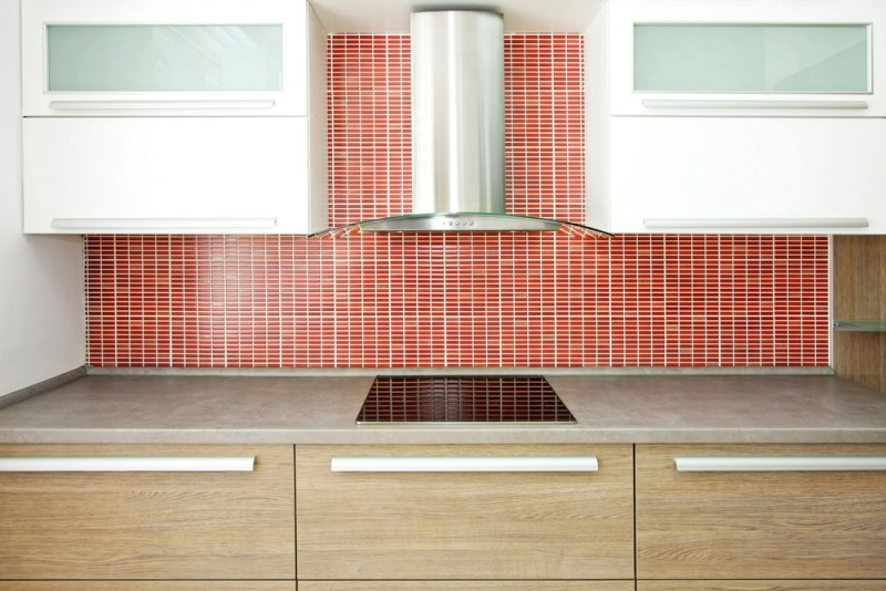 Big wooden counter and red ceramic wall min e1440270825777 - Striking Kitchen Backsplash Ideas & Pictures