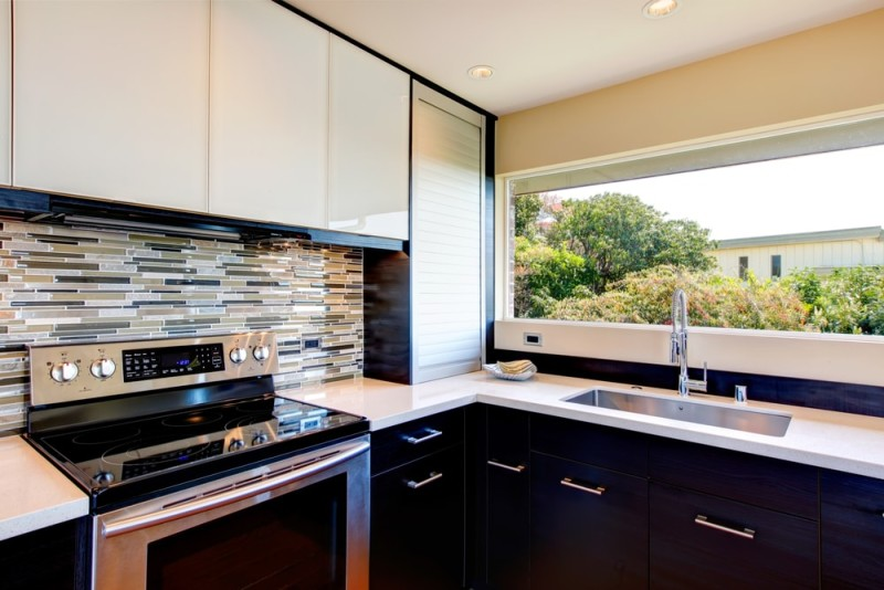 Black and white modern kitchen room with multi color backsplash min e1440270741863 - Striking Kitchen Backsplash Ideas & Pictures