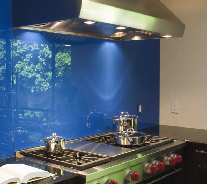 Blue backsplash and stainless steel vent hood in modern kitchen min e1440270678874 - Striking Kitchen Backsplash Ideas & Pictures