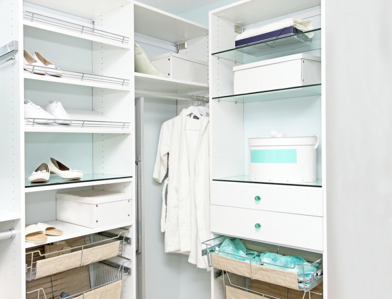 Large walk in closet with wardrobe showing shelves and hangers