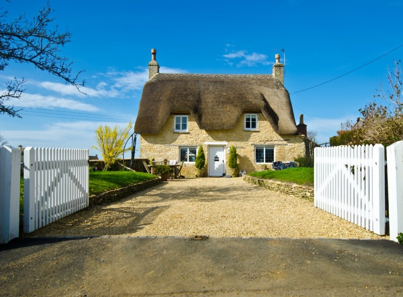 Cute English village cottage with road appeal and personality
