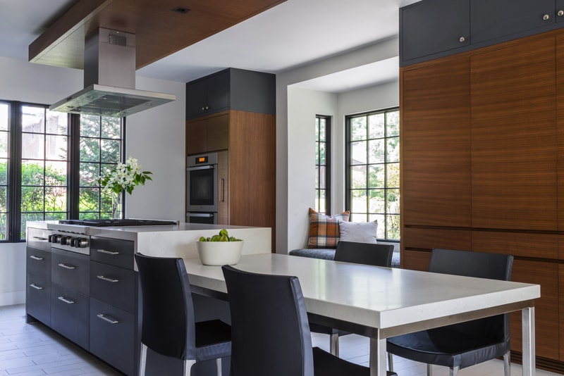 Kitchen with Island, bench dining extension and timber cabinetry