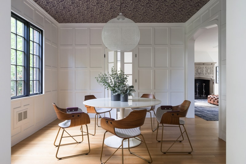 Magnificent dining room with wallpapered ceiling and panelled walls