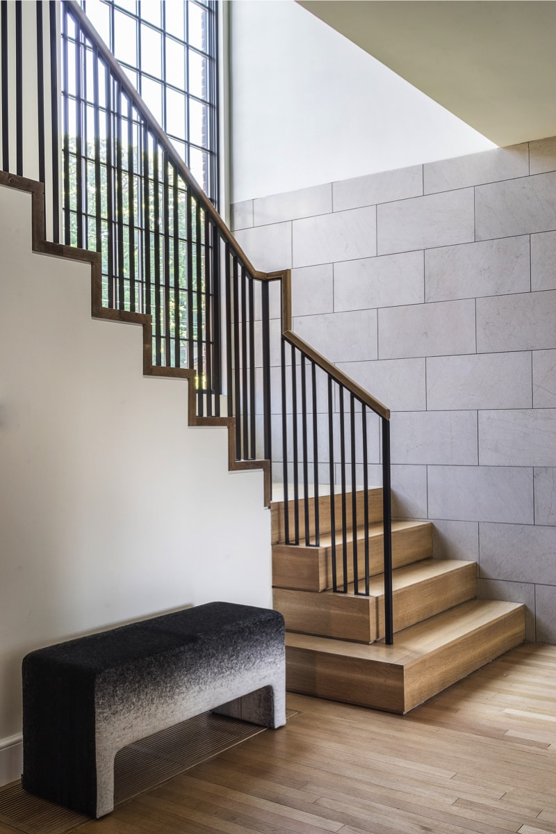 Staircase, block wall and timber floor