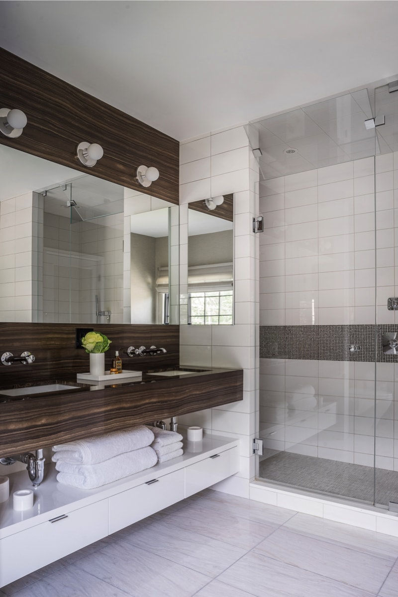 Bathroom vanity with adjoining walk-in shower compartment