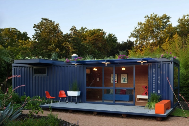 Long Blue Shipping Container Tiny House With Added Deck And Living Room Sliding Door Source