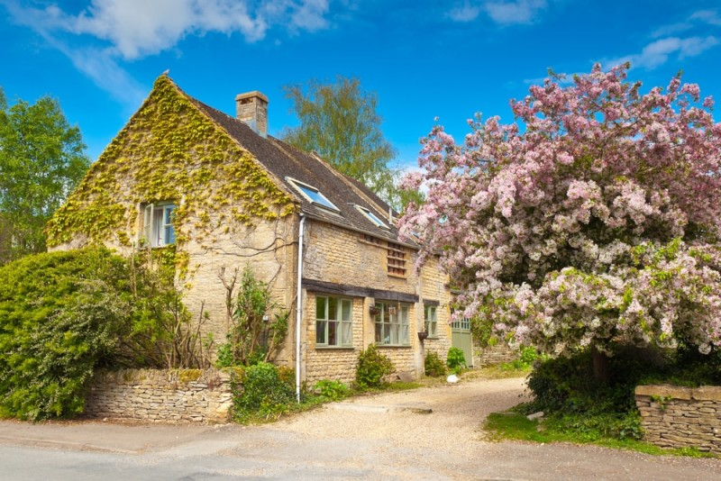 Traditional rural home with immaculate garden and pretty spring blossom tree