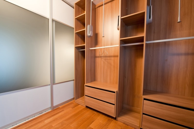 Empty walk in timber rich closet wardrobe