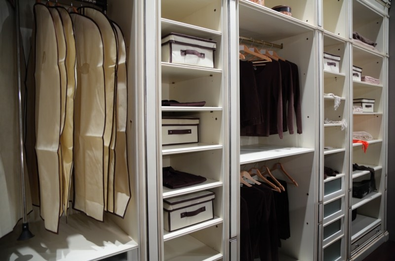 Large organised closet wardrobe with an abundance of shelf and hanger space