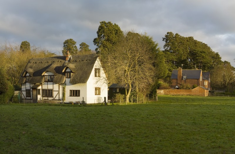 Farm house and cottage in a field in the English countryside