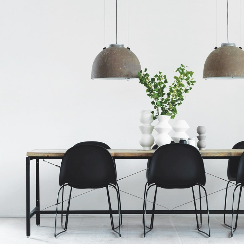 Powder coated aluminum and recycled teak dinner table with lamps from the streets of Copenhagen