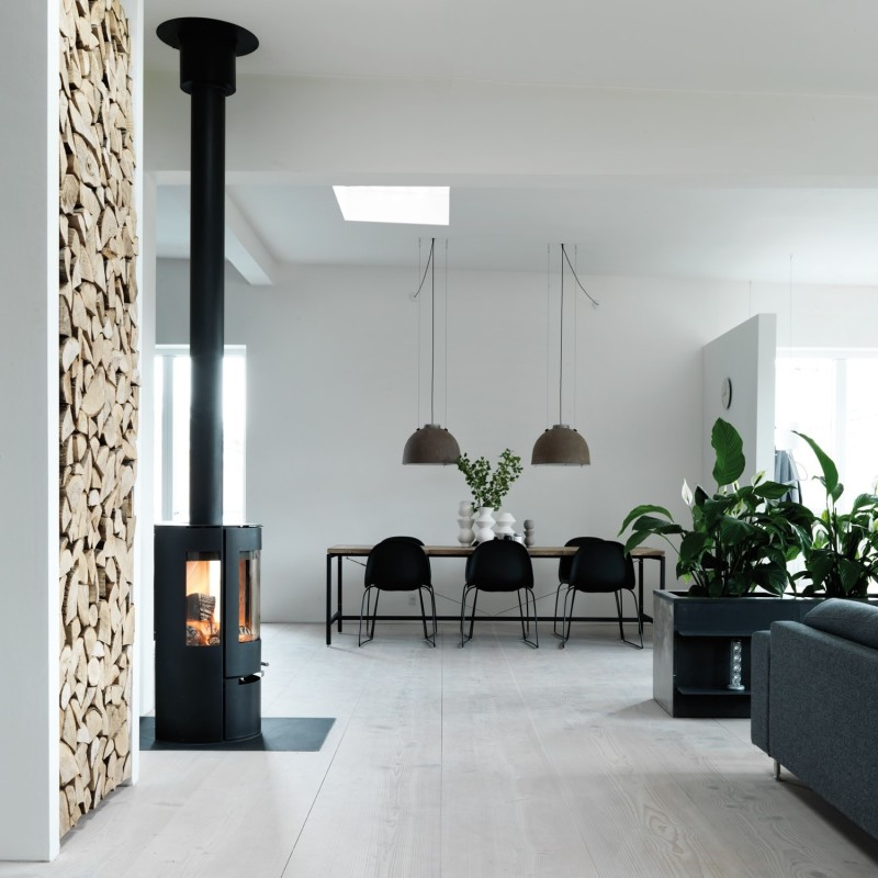 Dining area with fireplace in the left foreground and living area to the right