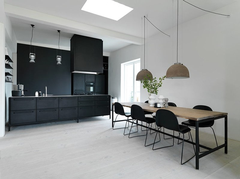 Eating section with kitchen and dining table.
