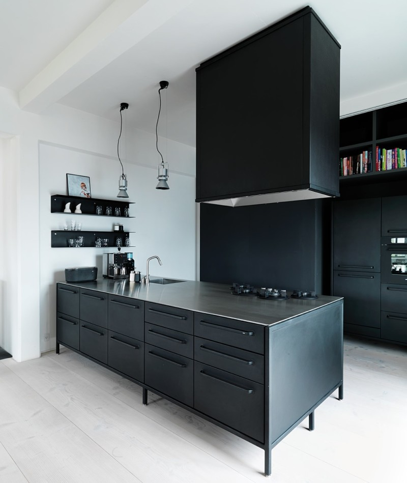 Kitchen from Vipp with matching cooking hood and shelves