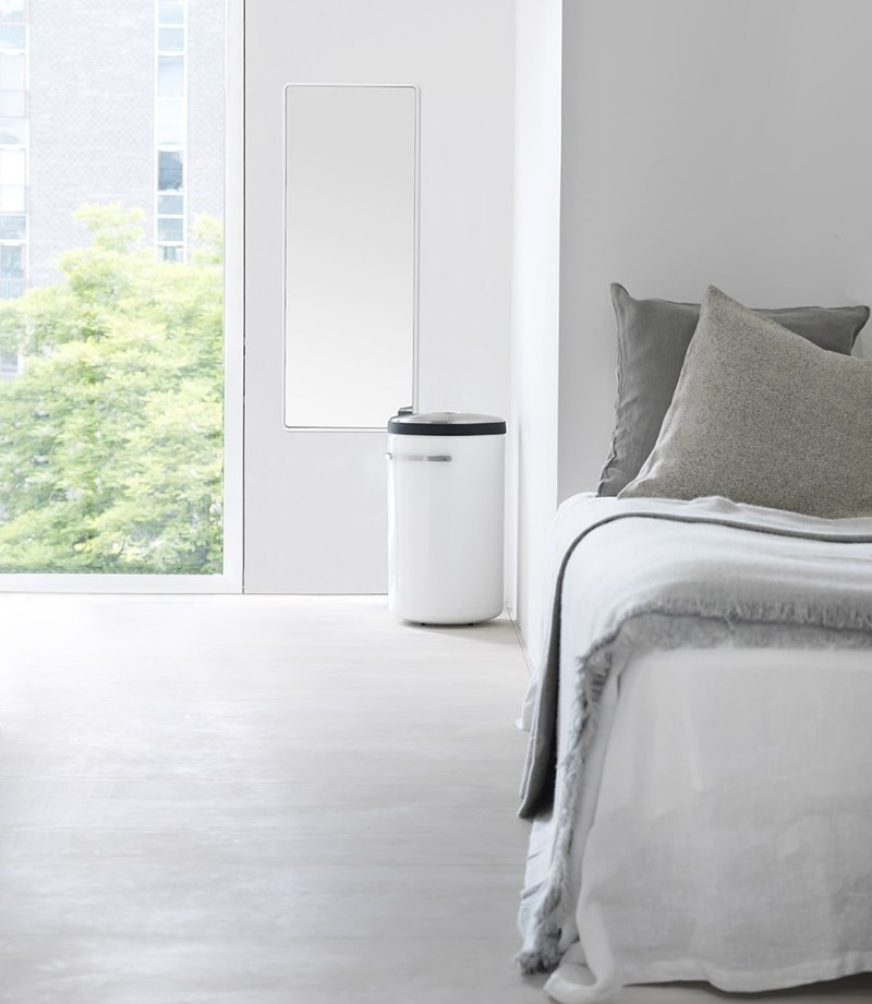 Master Bedroom with Mirror and laundry bin from Vipp