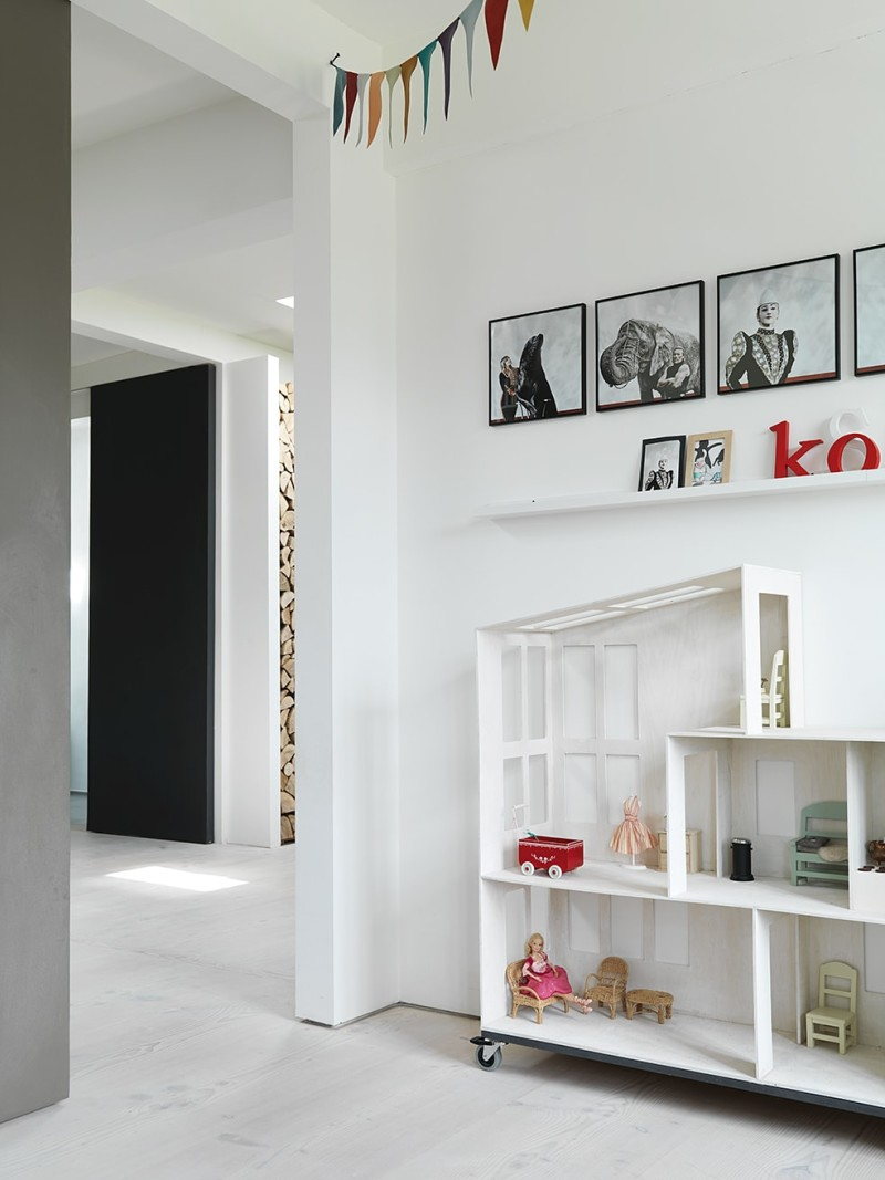 Children's room with homemade doll house. Wall pictures by photographer Kristine Funch.