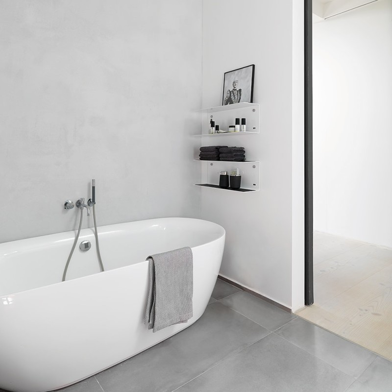Bathroom with wall shelves from Vipp