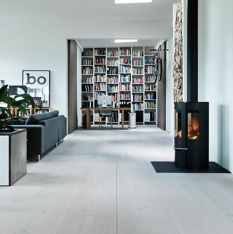Dinesen Douglas timber floor and Fire with glass that illuminates the space