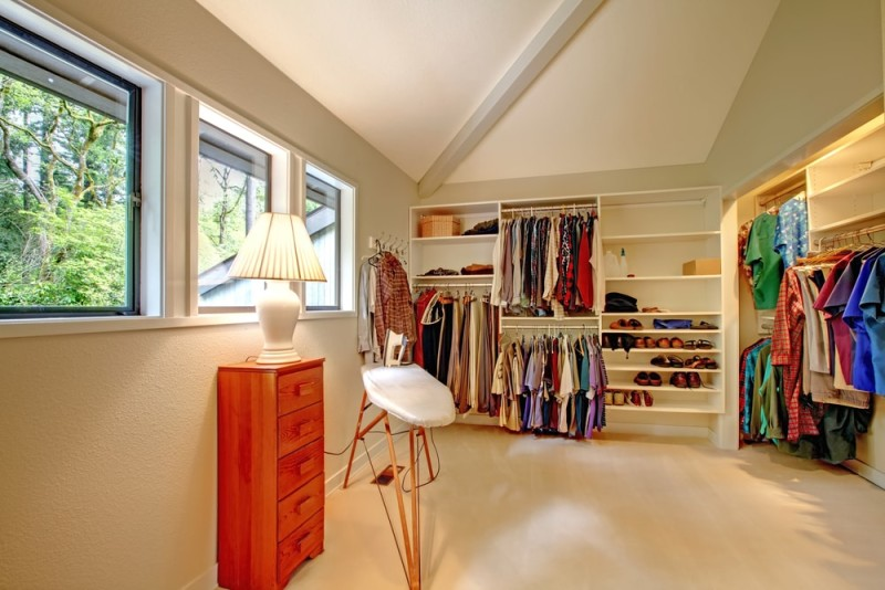 Large walk in upstairs closet with ironing board