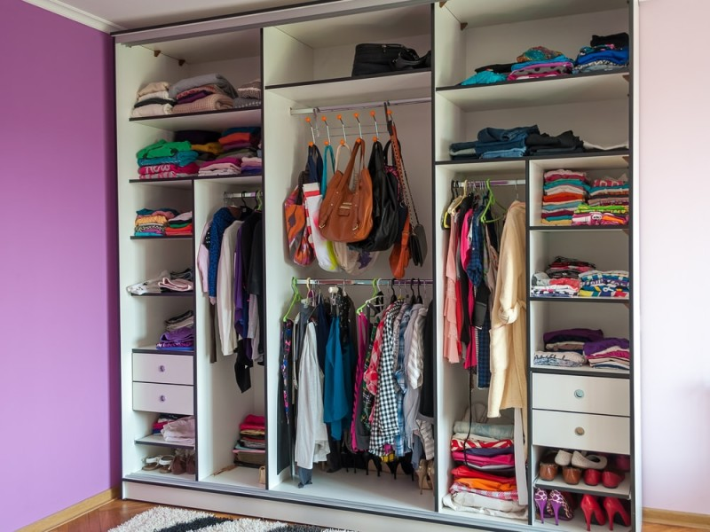 Wardrobe closet with clothes, shoes and bags all in one place
