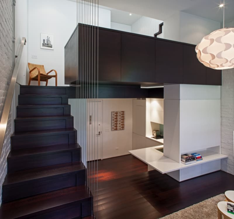 Manhattan loft apartment showing overall wide perspective view of the whole micro-apartment