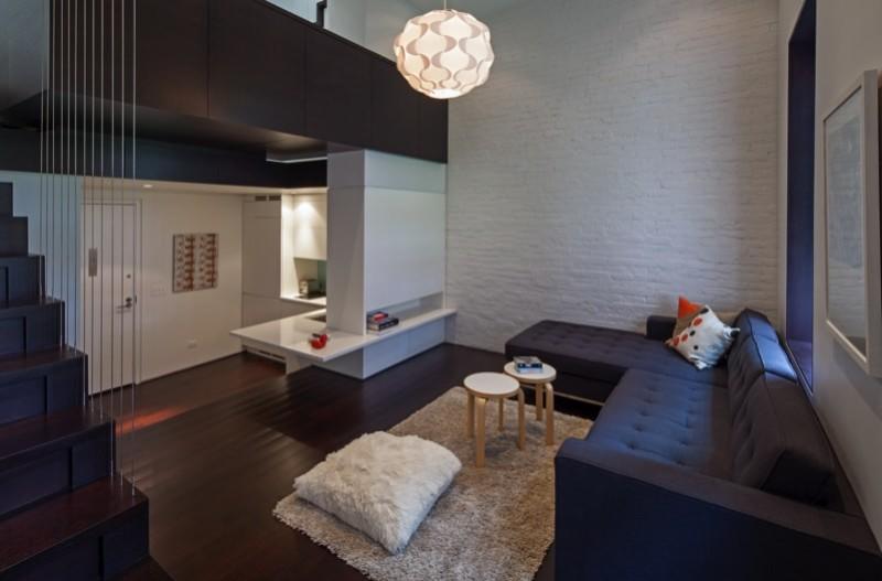 Beautiful cosy living room with mezzanine floating bedroom