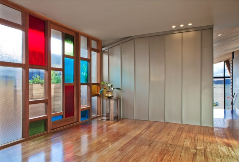 Entrance foyer showing stained glass windows and rich timber floor