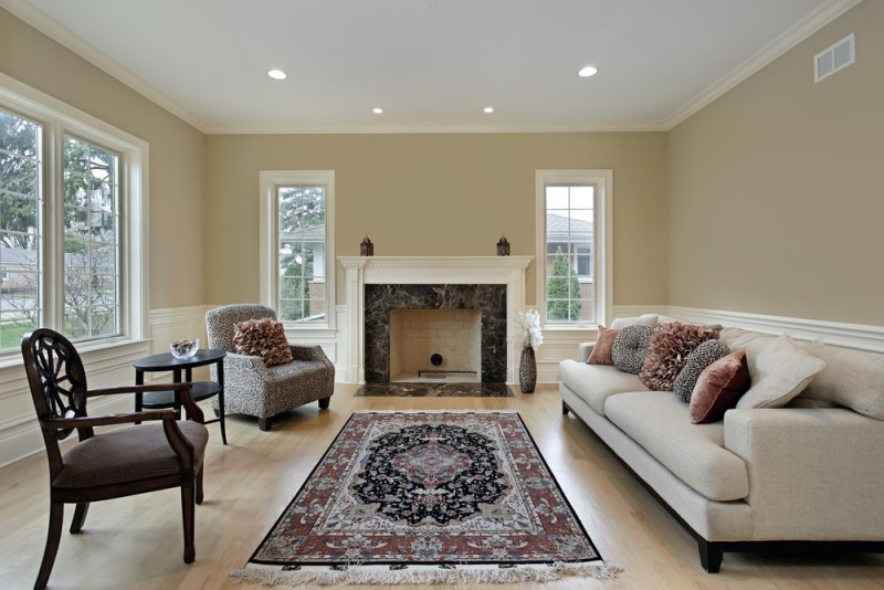 Living Room In Luxury Home With A Feature Focal Point Fireplace