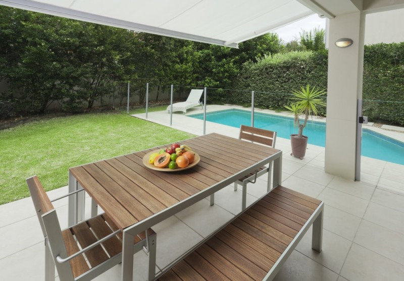 Outdoor Dining Areas  Suburban Under Cover Backyard With Outdoors Dining  Table Setting And Swimming Pool