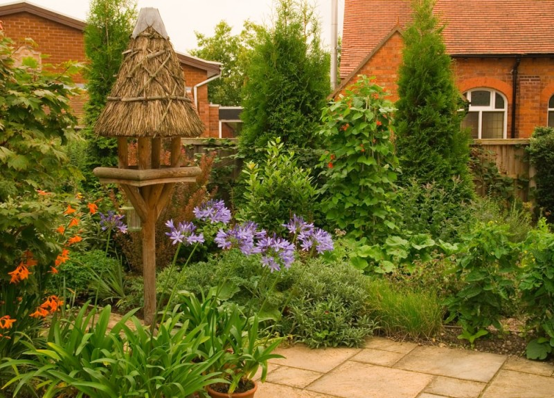 Quaint English Cottage Garden With Chapel In The Background Min E1441669747528