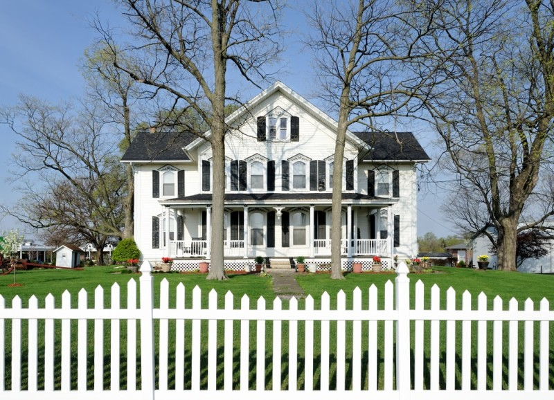 Large White House With White Picket Fence
