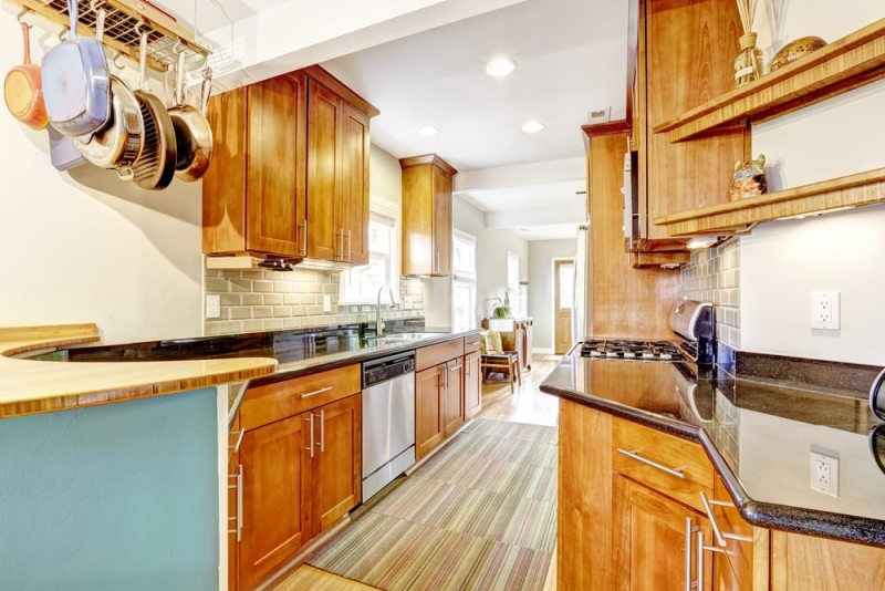 Bright brown kitchen cabinets with black granite tops min e1443807416826 - Kitchen Pot Shelves and Hanging Pot and Pans