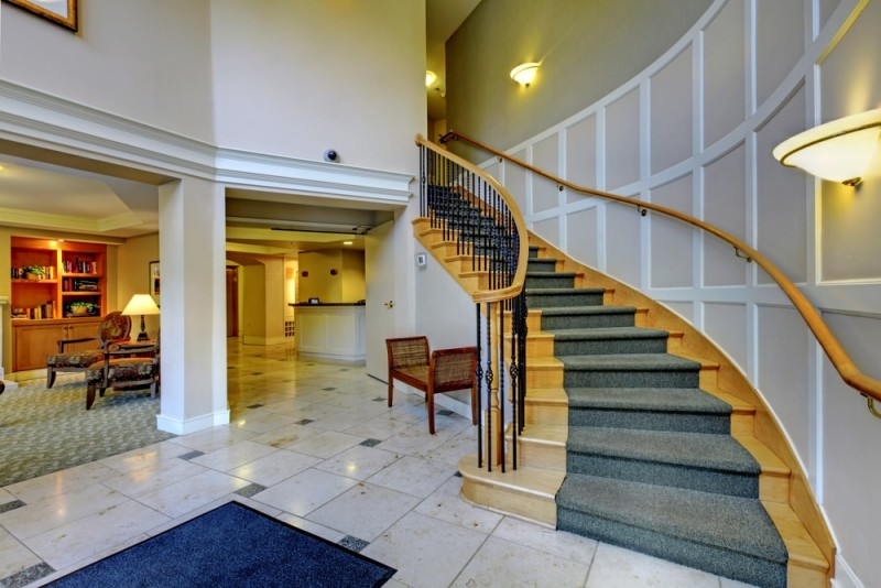 Open Foyer Designs : Open plan foyer with palatial columns and wooden staircase