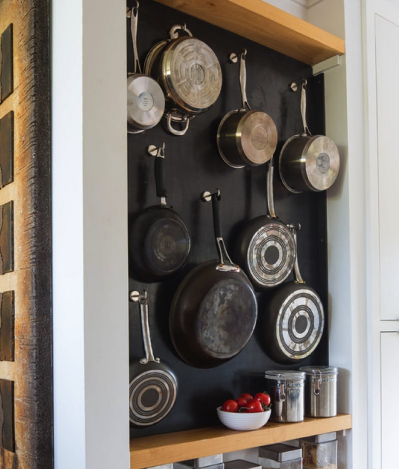 Hanging pots and saucepans Source www.thekitchn.com min - Kitchen Pot Shelves and Hanging Pot and Pans