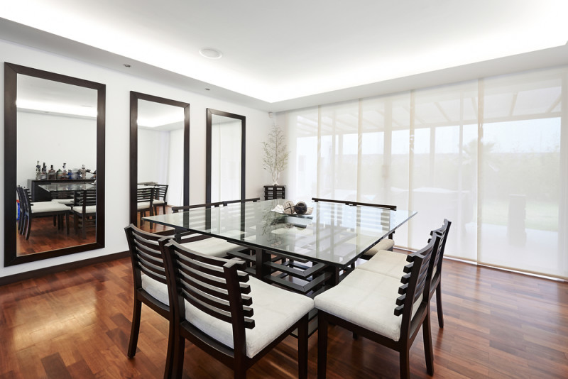 the above dining table is situated in a very stylish dining room area