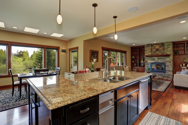 Luxury kitchen with bar style granite kitchen island