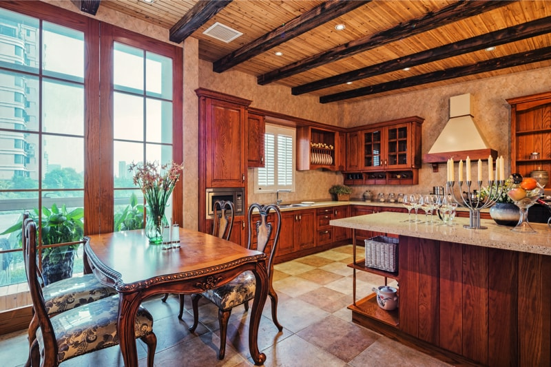 Country look kitchen with wooden cabinets and wooden ceiling