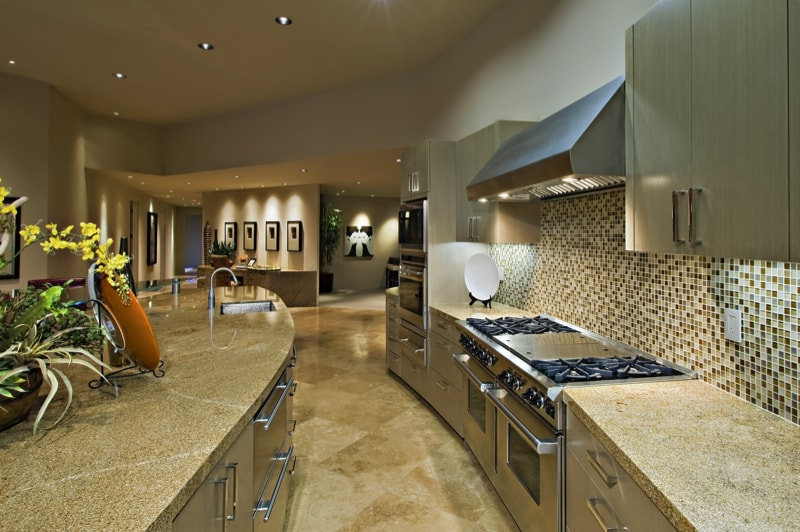 Soft curves in this kitchen design with tiled splash back