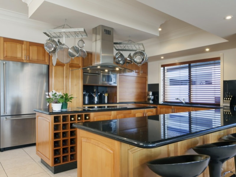 Stylish kitchen in luxurious house min e1443806430338 - Kitchen Pot Shelves and Hanging Pot and Pans