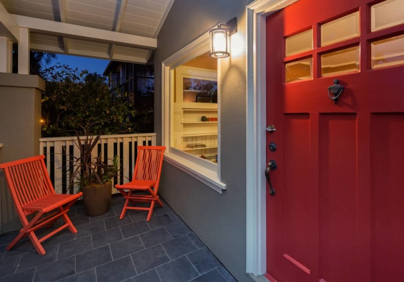 red front doors. Twilight photo of red front door within porch and seating arrangement min  e1444471980895 Red Doors on Houses