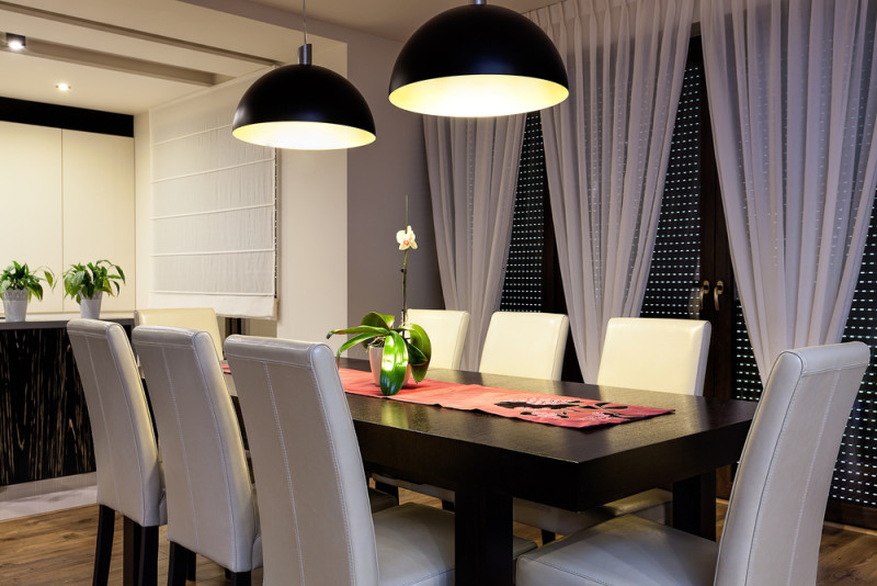 here we have an urban apartment dining room with a dark stained wooden