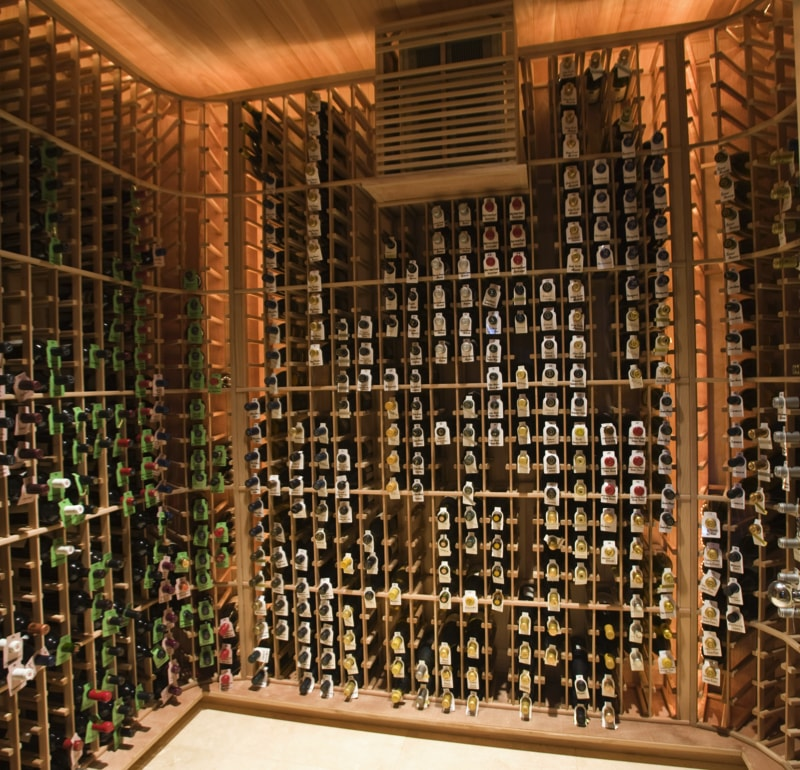 View of racks with wine bottles at domestic wine cellar min - Home Bar Pictures and Home Wine Storage
