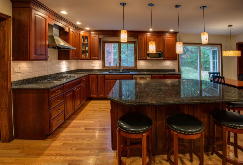 kitchen with granite counter top hardwood cabinet and floor.