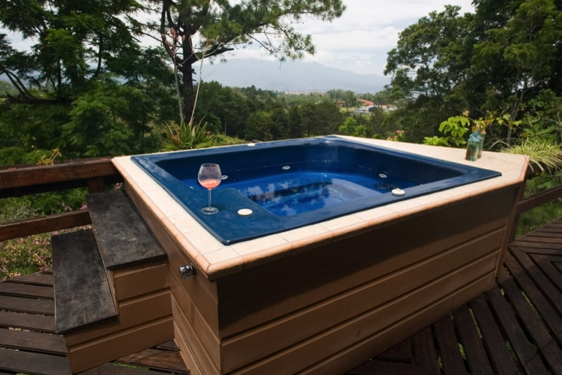 A Hot tub with a view of the mountains min - 27 Home Hot Tubs and Spa Pools