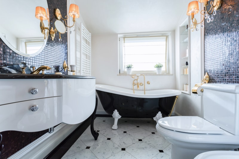 Black and white bathroom in luxury home with gold accessories
