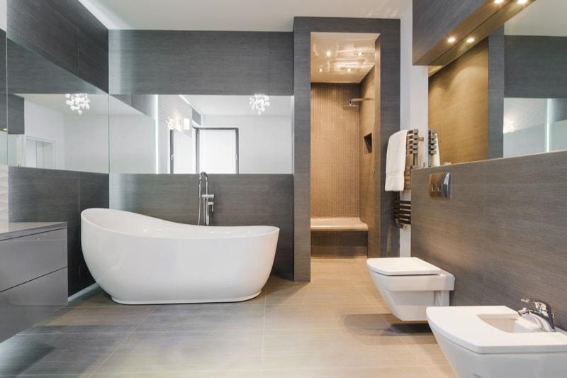 Freestanding white bath in a grey tiled modern bathroom. 49 Relaxing Bathroom Design and Cool Bathroom Ideas