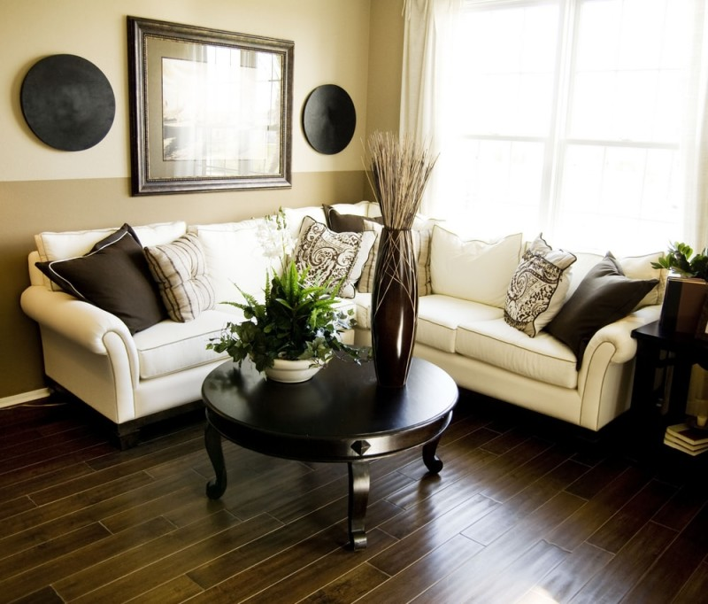 A beautiful living room with a dark colored hard wood floor