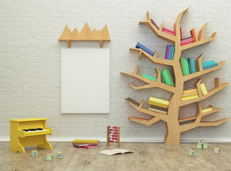 Kids games room with painted brick walls and feature tree shaped bookcase