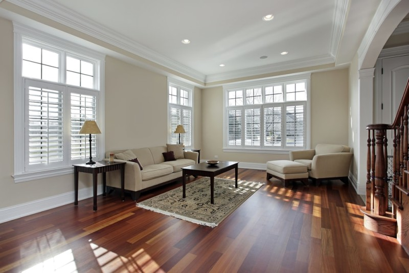 Hardwood flooring ideas for living rooms with rich cherry hardwood floor