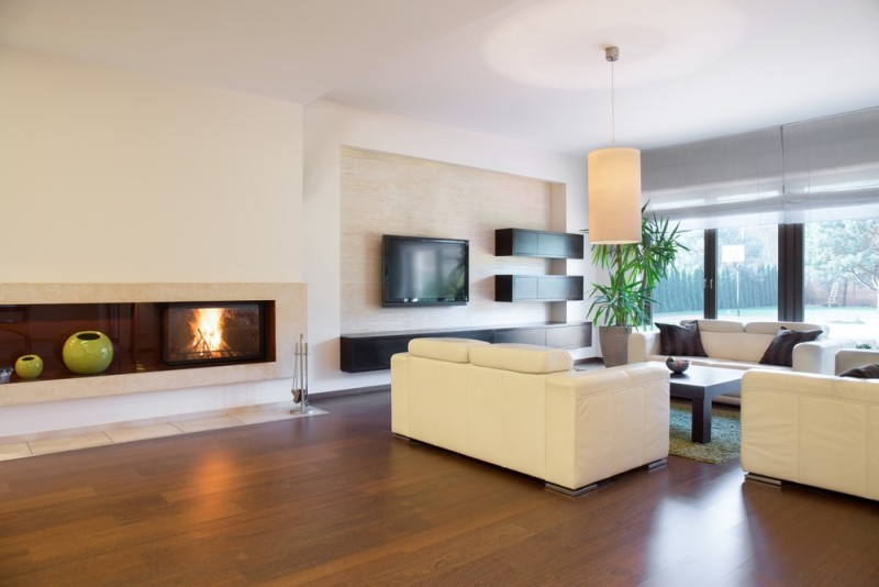Spacious But Cozy Living Room With Fireplace And Luxurious Timber